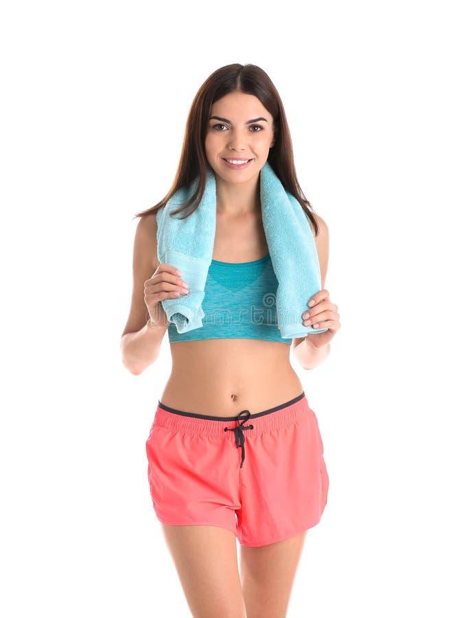 Όμορφη νέα γυναίκα sportswear με την πετσέτα στοκ φωτογραφία με δικαίωμα ελεύθερης χρήσης