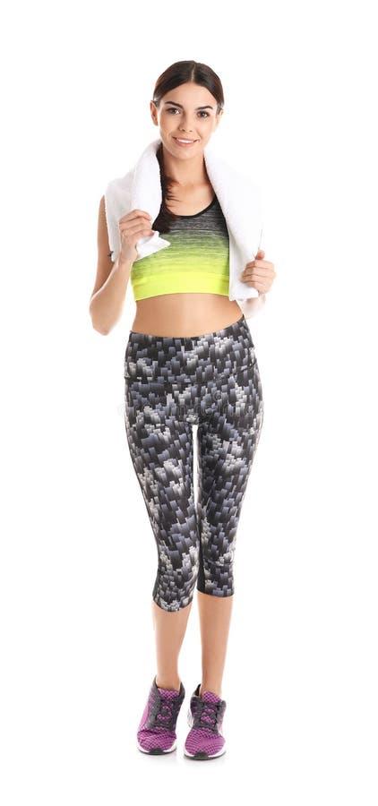 Όμορφη νέα γυναίκα sportswear με την πετσέτα στοκ εικόνες με δικαίωμα ελεύθερης χρήσης
