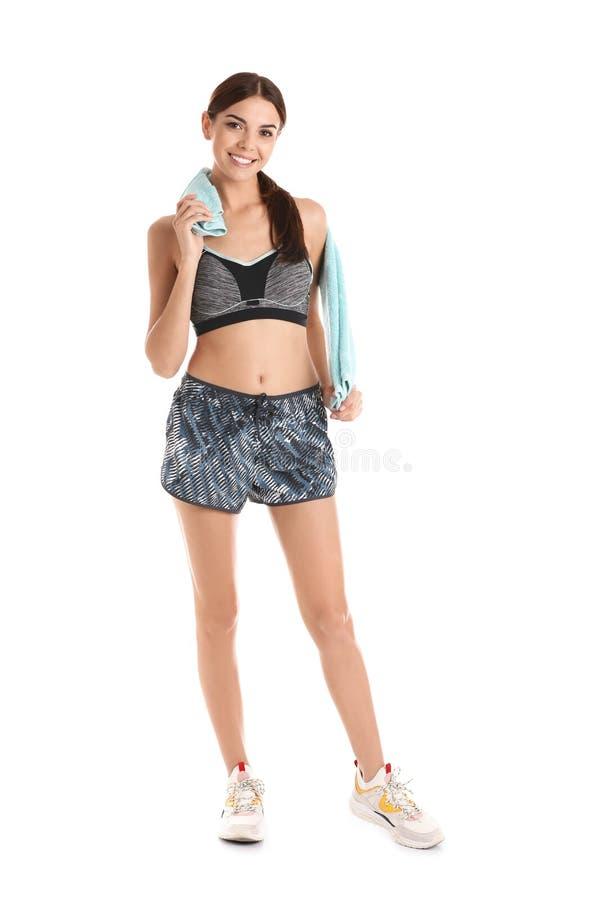 Όμορφη νέα γυναίκα sportswear με την πετσέτα στοκ εικόνες