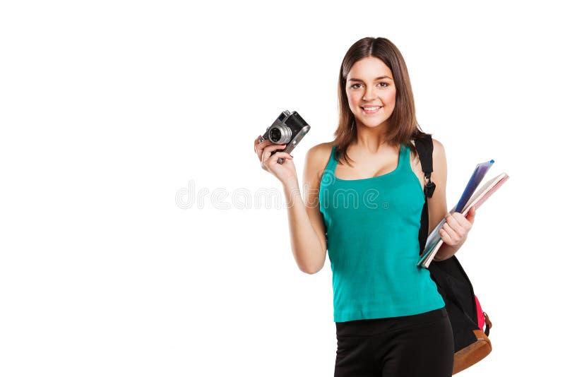 Όμορφη νέα τοποθέτηση γυναικών σπουδαστών με στοκ φωτογραφία