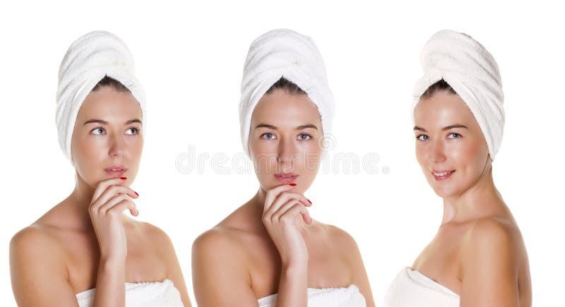 Όμορφη νέα τοποθέτηση γυναικών στην άσπρη πετσέτα στοκ εικόνες
