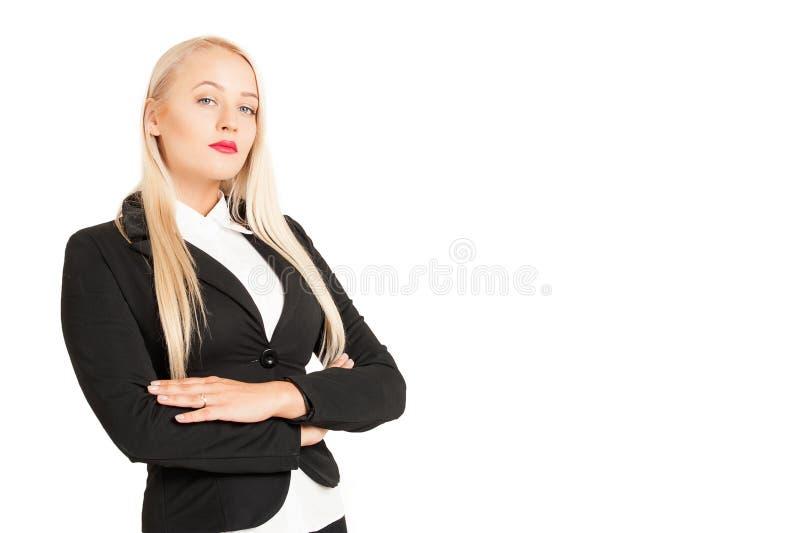 Όμορφη ξανθή στάση επιχειρησιακών γυναικών στοκ φωτογραφίες