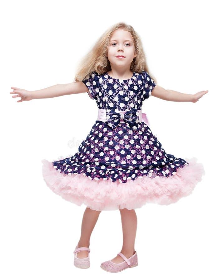 Όμορφη περιστροφή μικρών κοριτσιών γύρω από απομονωμένος στοκ εικόνες με δικαίωμα ελεύθερης χρήσης