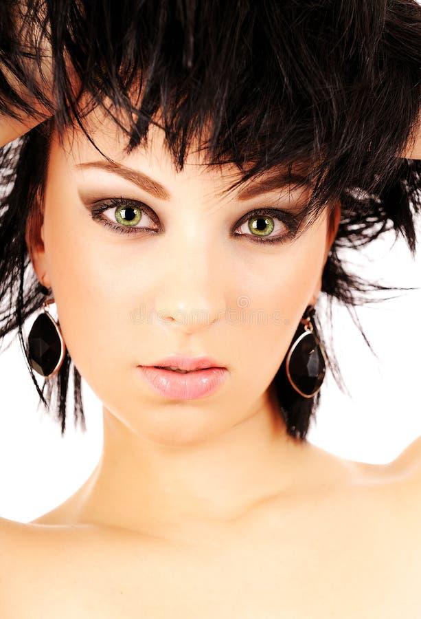 όμορφη πράσινη γυναίκα ματιώ& στοκ εικόνες