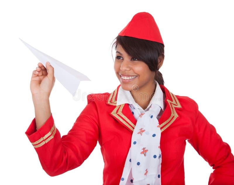 όμορφη προωθώντας χαμογελώντας αεροσυνοδός θέσεων στοκ φωτογραφίες με δικαίωμα ελεύθερης χρήσης