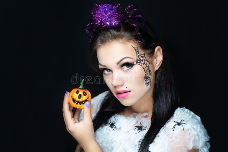 Όμορφη τέχνη κοριτσιών makeup με τις αράχνες στοκ εικόνες