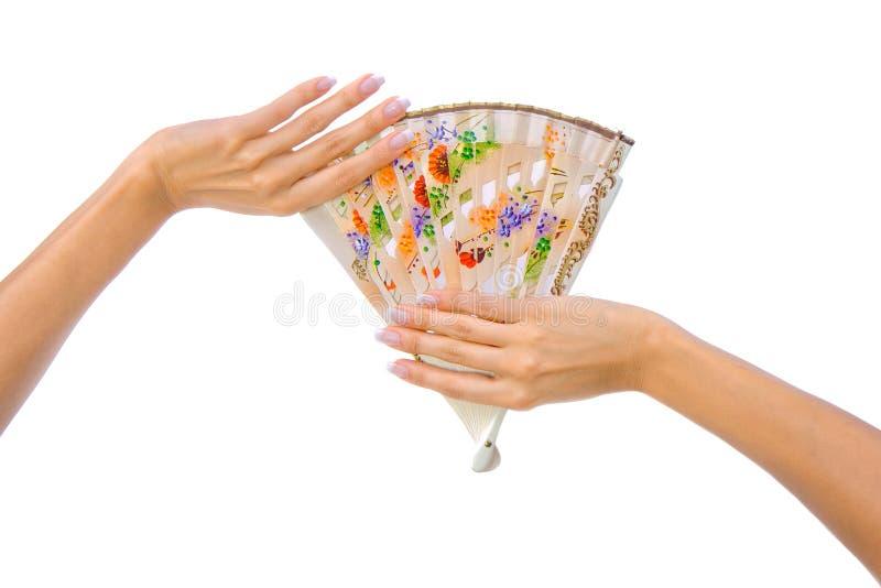 Όμορφος ανεμιστήρας στο χέρι γυναικών στοκ φωτογραφία με δικαίωμα ελεύθερης χρήσης