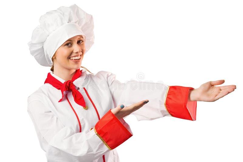 Όμορφος αρχιμάγειρας που παρουσιάζει με τα χέρια στοκ φωτογραφία
