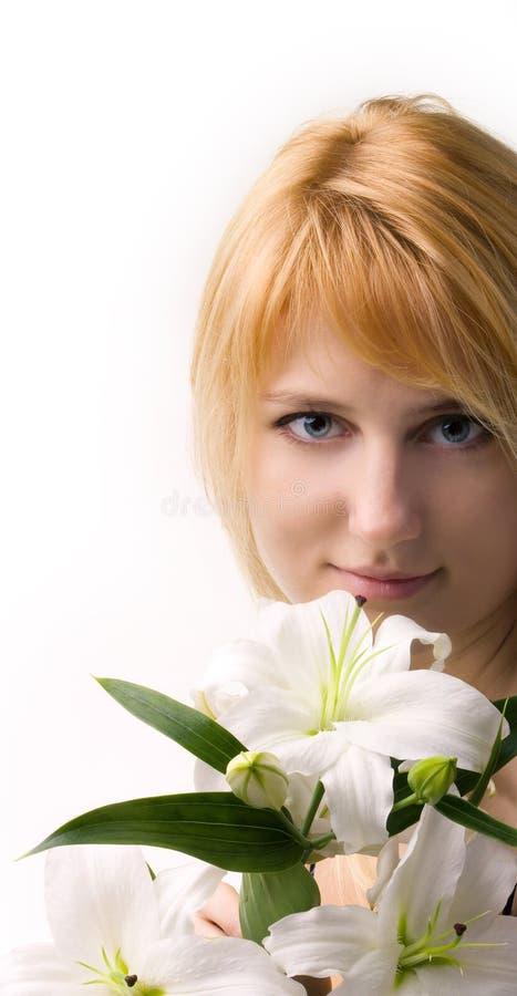 όμορφος κρίνος κοριτσιών λουλουδιών στοκ φωτογραφία με δικαίωμα ελεύθερης χρήσης