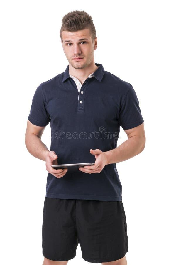 Όμορφος νέος προσωπικός εκπαιδευτής με το PC ταμπλετών στοκ φωτογραφίες με δικαίωμα ελεύθερης χρήσης