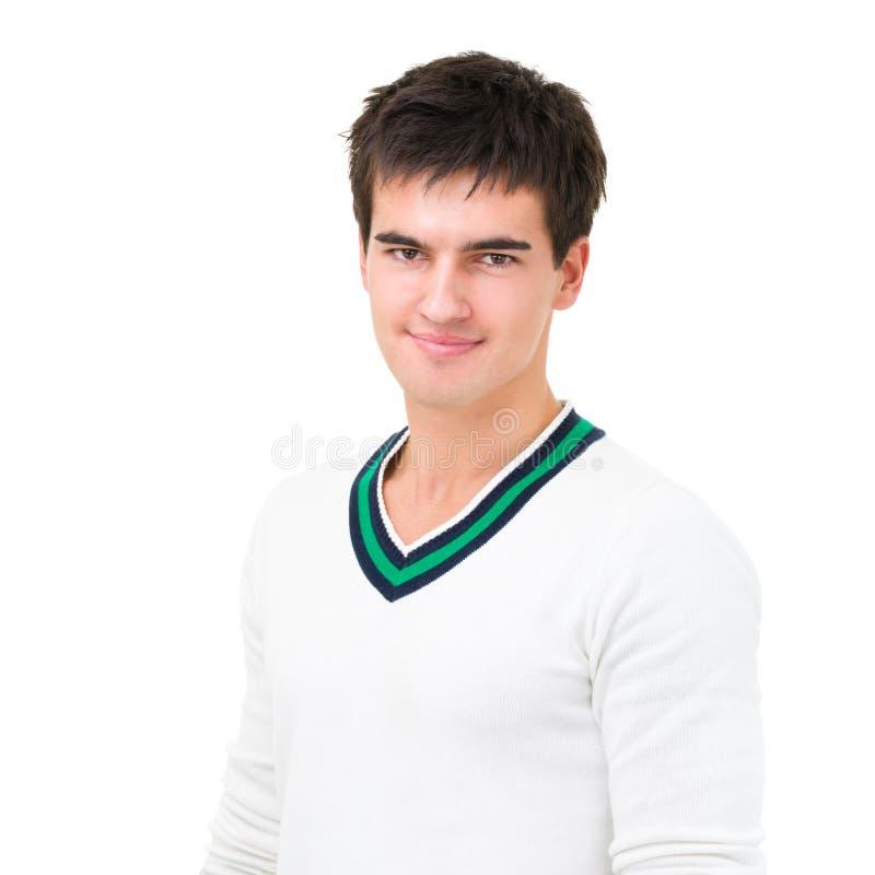 Όμορφος νεαρός άνδρας με ένα γοητευτικό χαμόγελο στοκ φωτογραφία