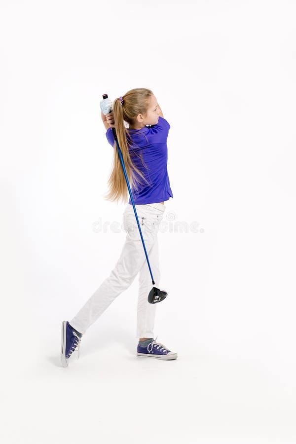 Όμορφος παίκτης γκολφ κοριτσιών στο άσπρο backgroud στο στούντιο στοκ εικόνα με δικαίωμα ελεύθερης χρήσης