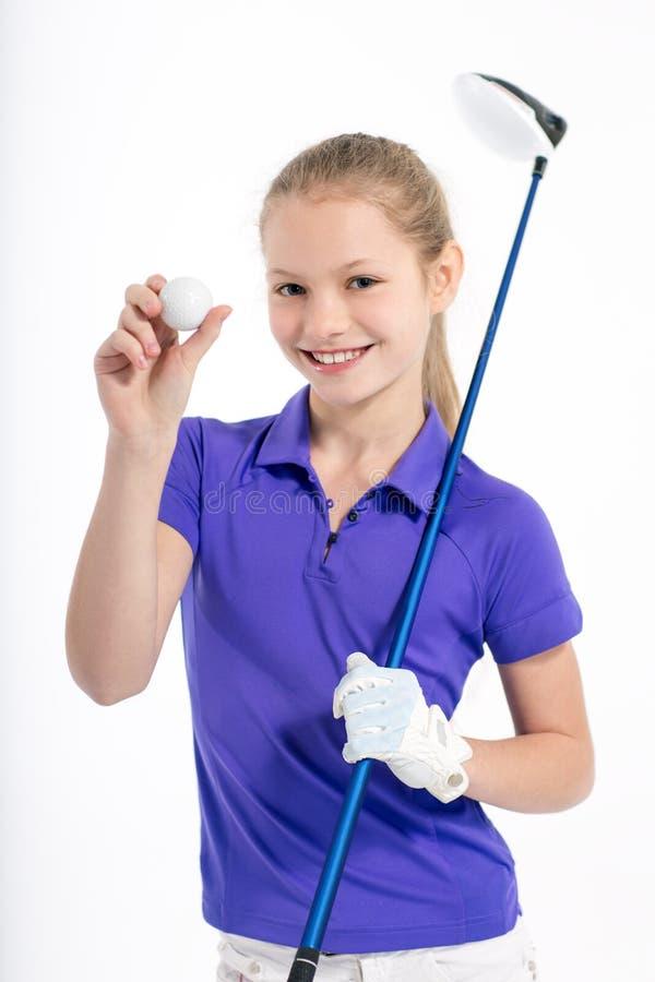 Όμορφος παίκτης γκολφ κοριτσιών στο άσπρο backgroud στο στούντιο στοκ φωτογραφίες με δικαίωμα ελεύθερης χρήσης