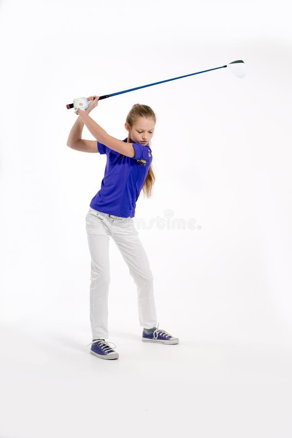Όμορφος παίκτης γκολφ κοριτσιών στο άσπρο backgroud στο στούντιο στοκ φωτογραφία με δικαίωμα ελεύθερης χρήσης