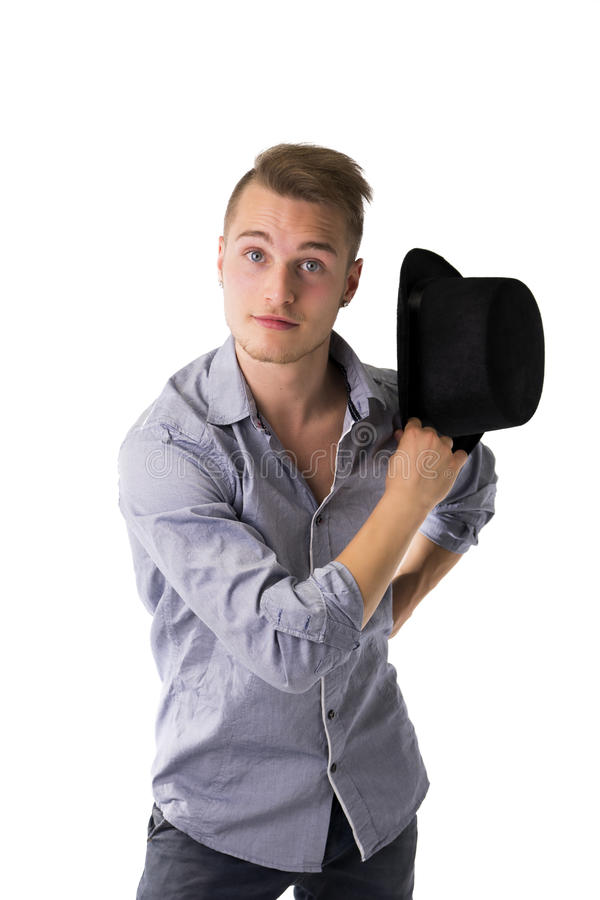 Όμορφος, δροσερός, βέβαιος νεαρός άνδρας με το τοπ καπέλο στοκ φωτογραφία με δικαίωμα ελεύθερης χρήσης
