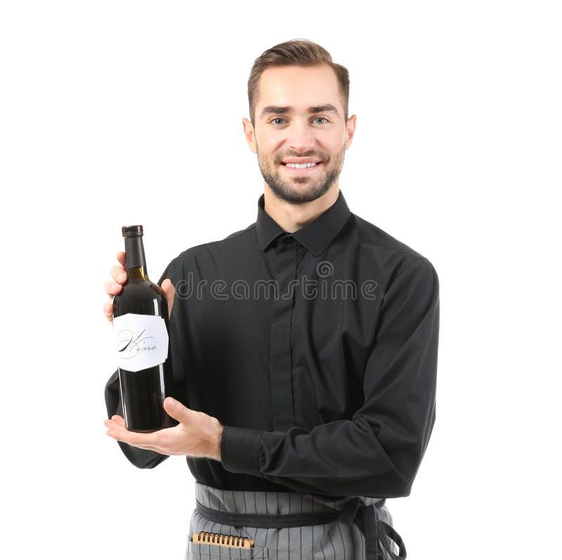 Όμορφος σερβιτόρος με το μπουκάλι του κρασιού στοκ φωτογραφίες