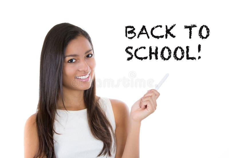 όμορφος σπουδαστής ή δάσκαλος που γράφει πίσω στο σχολείο στοκ φωτογραφίες