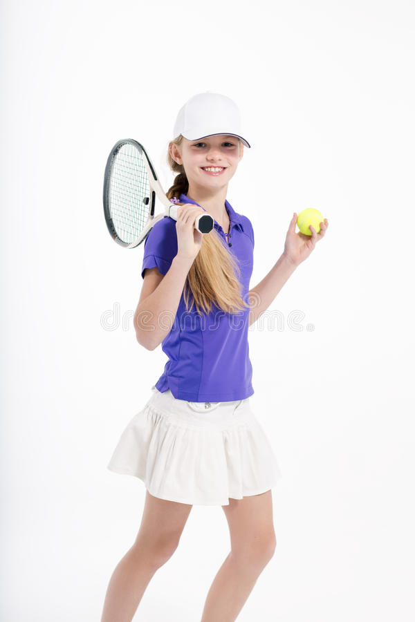 Όμορφος τενίστας κοριτσιών στο άσπρο backgroud στο στούντιο στοκ φωτογραφίες