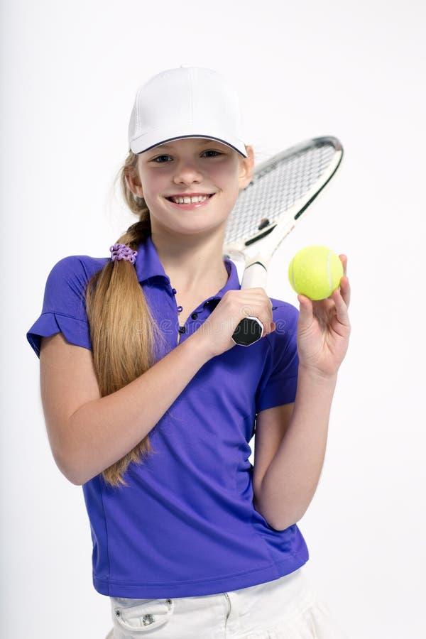 Όμορφος τενίστας κοριτσιών στο άσπρο backgroud στο στούντιο στοκ φωτογραφία