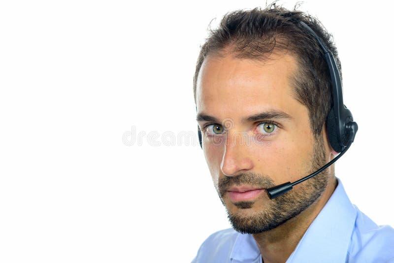 Όμορφος χειριστής εξυπηρέτησης πελατών που φορά μια κάσκα στοκ εικόνα με δικαίωμα ελεύθερης χρήσης