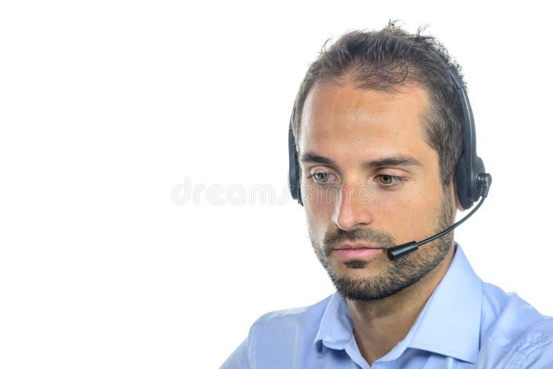 Όμορφος χειριστής εξυπηρέτησης πελατών που φορά μια κάσκα στοκ φωτογραφίες