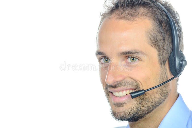 Όμορφος χειριστής εξυπηρέτησης πελατών που φορά μια κάσκα στοκ εικόνες