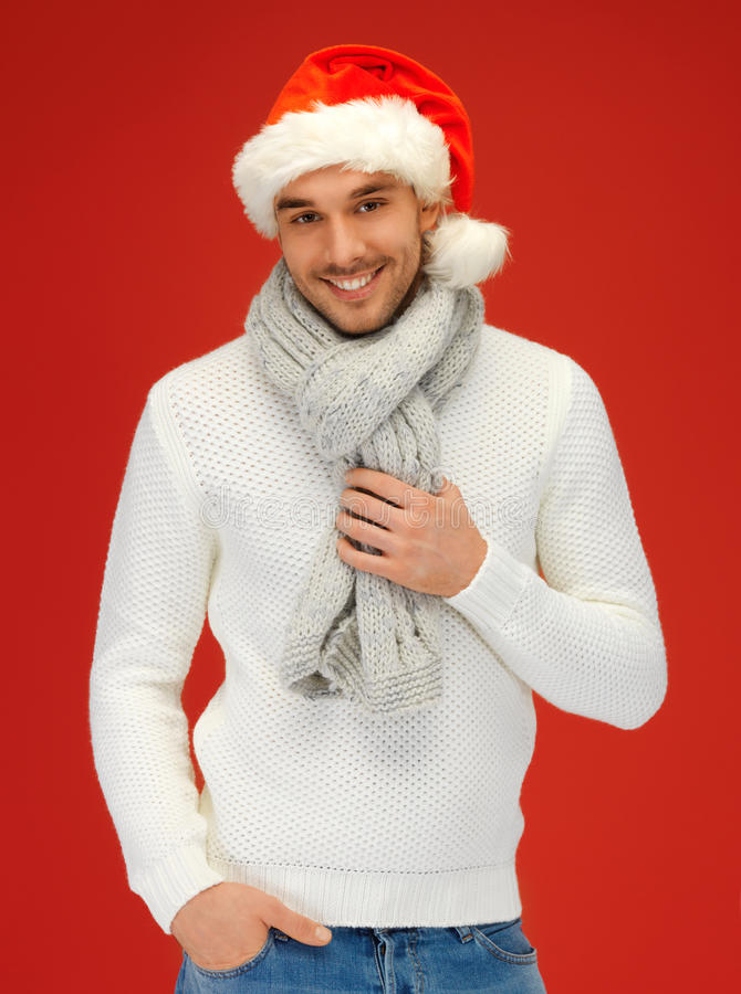 Όμορφο άτομο στο καπέλο Χριστουγέννων στοκ εικόνα με δικαίωμα ελεύθερης χρήσης