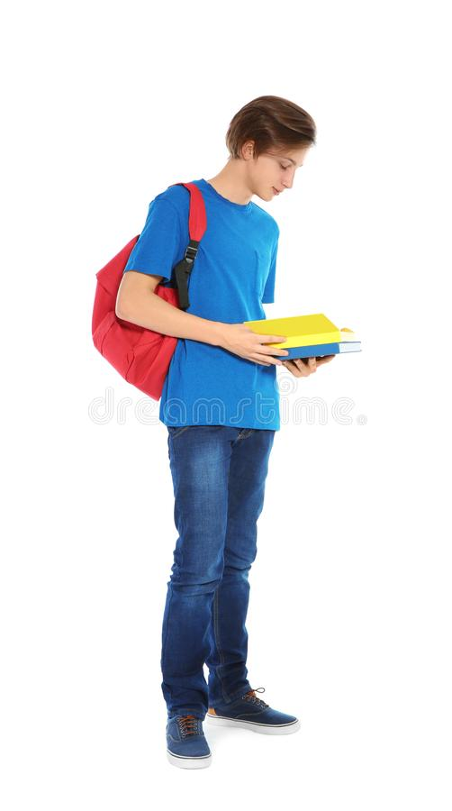 Όμορφο αγόρι εφήβων με τα βιβλία στοκ εικόνα