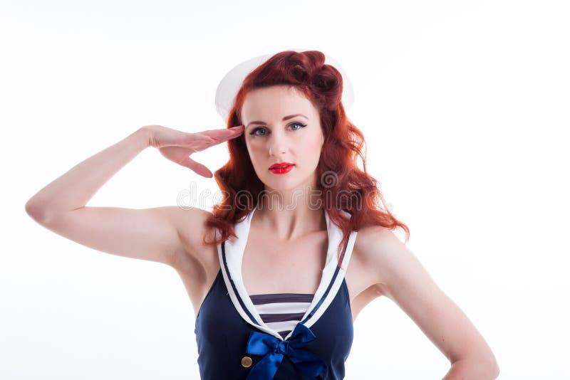 Όμορφο αναδρομικό καρφίτσα-επάνω κορίτσι σε ένα φόρεμα ύφους ναυτικών στοκ εικόνα
