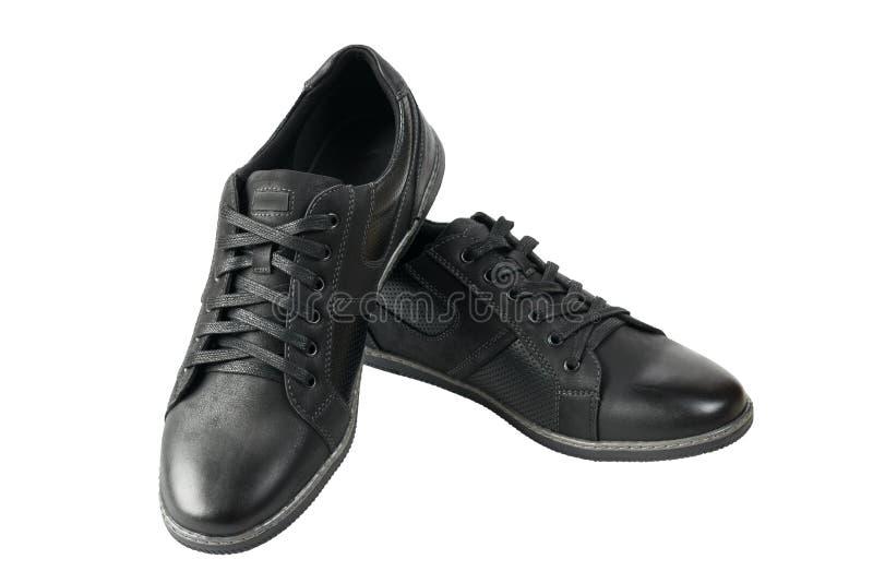 Όμορφο ζευγάρι των αθλητικών παπουτσιών των μαύρων που απομονώνεται στο άσπρο υπόβαθρο στοκ φωτογραφία με δικαίωμα ελεύθερης χρήσης