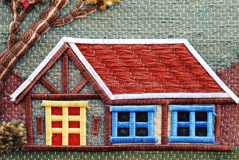 Όμορφο κεντημένο σπίτι νήμα, σημάδι συμβόλων υποβάθρου στοκ φωτογραφίες
