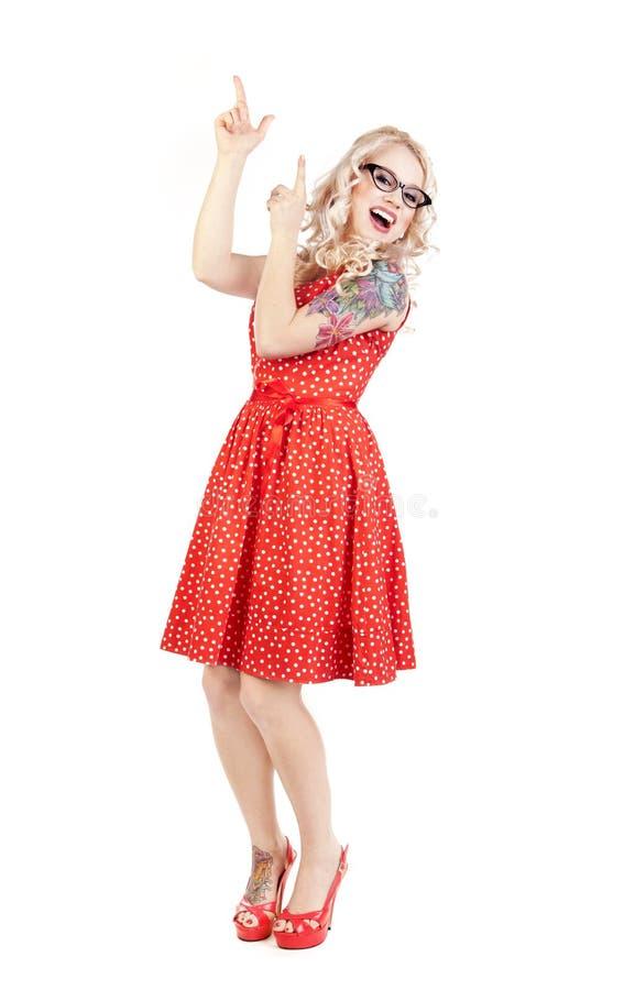 Όμορφο κορίτσι που δείχνει επάνω στοκ φωτογραφίες