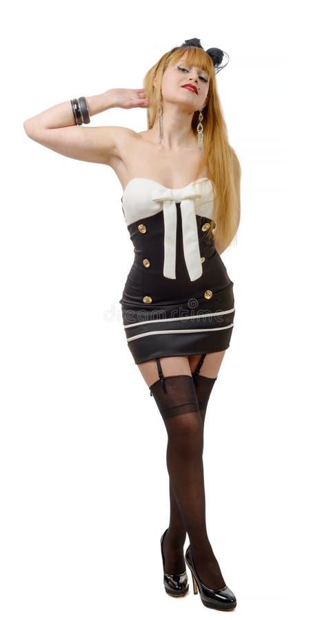 Όμορφο κορίτσι στο καρφίτσα-επάνω ύφος με τις μαύρες γυναικείες κάλτσες στοκ φωτογραφία με δικαίωμα ελεύθερης χρήσης