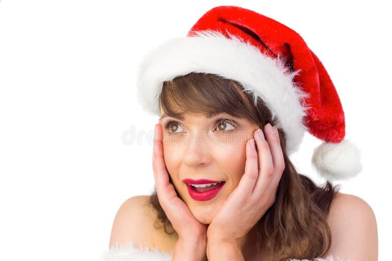Όμορφο κορίτσι santa με τα χέρια στο πρόσωπο στοκ εικόνες