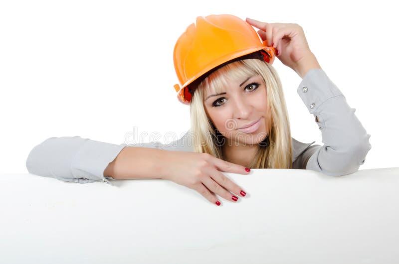 όμορφο κράνος κοριτσιών οικοδόμησης στοκ εικόνες