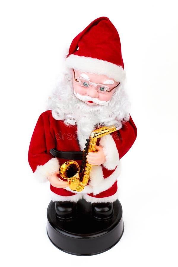 Όμορφο παιχνίδι Άγιου Βασίλη με το saxophone στοκ εικόνα με δικαίωμα ελεύθερης χρήσης