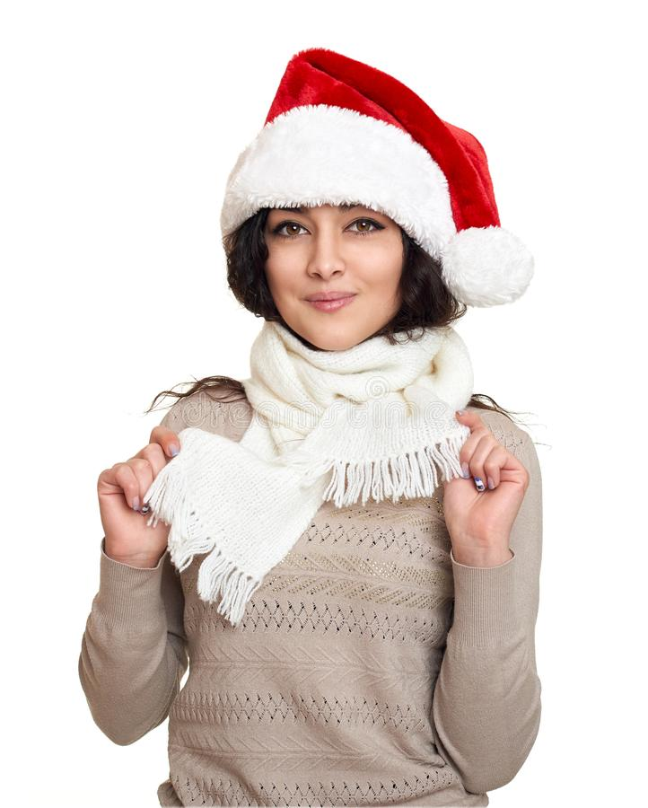 Όμορφο πορτρέτο κοριτσιών που ντύνεται στο καπέλο santa Άσπρη ανασκόπηση Νέες παραμονή έτους και έννοια χειμερινών διακοπών στοκ φωτογραφίες με δικαίωμα ελεύθερης χρήσης