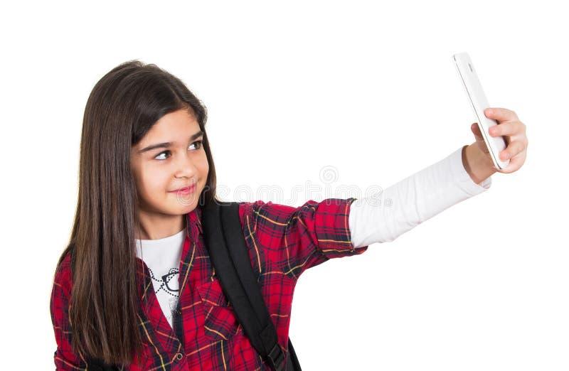 Όμορφο σχολικό κορίτσι που κάνει selfie στοκ εικόνα με δικαίωμα ελεύθερης χρήσης