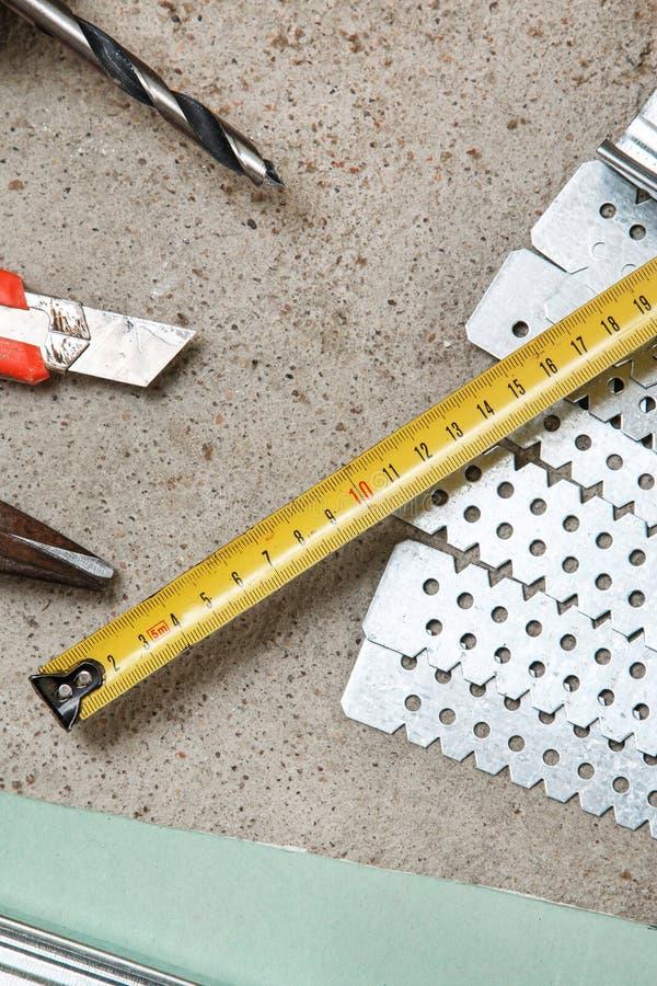 Όργανα για την κατασκευή τοίχοι μιας γυψοσανίδας στοκ φωτογραφία με δικαίωμα ελεύθερης χρήσης