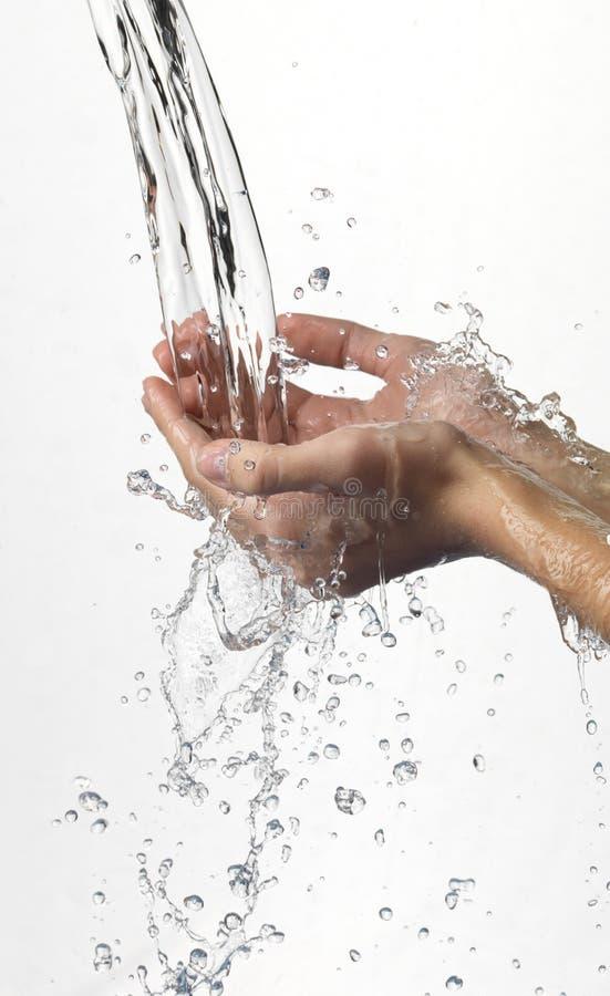 ύδωρ ρευμάτων χεριών στοκ εικόνες