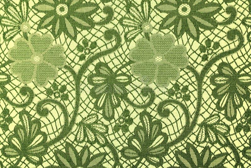 Ύφασμα στα πράσινα λουλούδια, ένα υπόβαθρο στοκ εικόνες με δικαίωμα ελεύθερης χρήσης