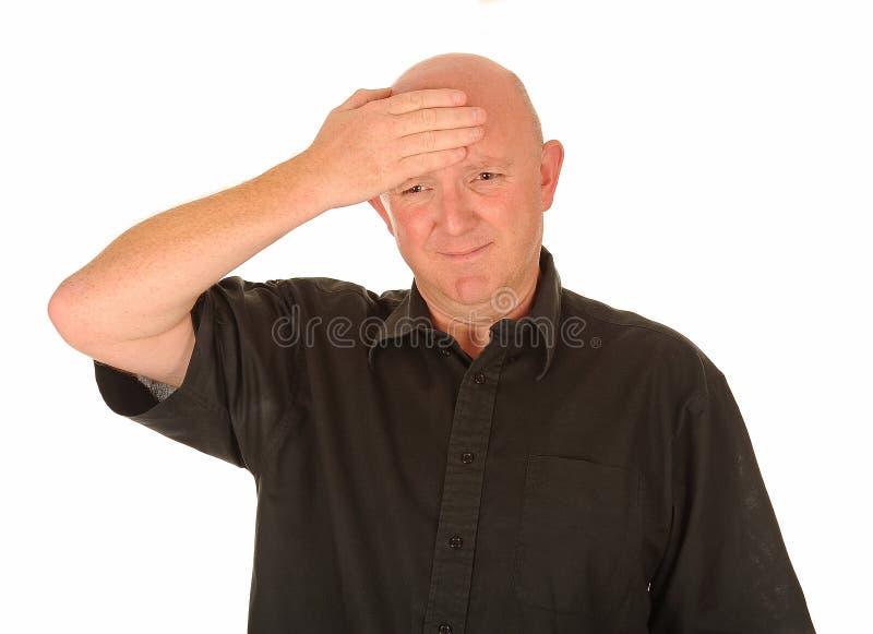 Ώριμο άτομο με τον πονοκέφαλο στοκ φωτογραφίες