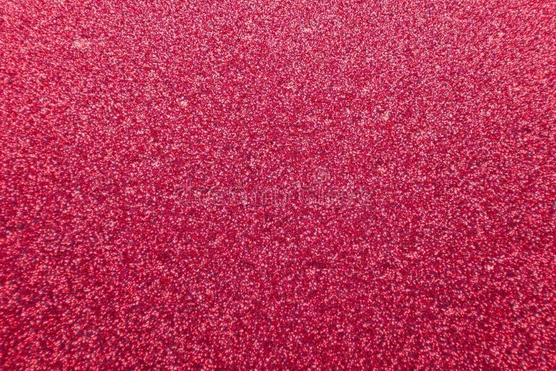 Абстрактная красная текстурированная предпосылка яркого блеска с грубым стоковое изображение