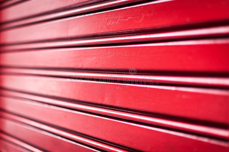 Абстрактная предпосылка красных нашивок металла. стоковое изображение