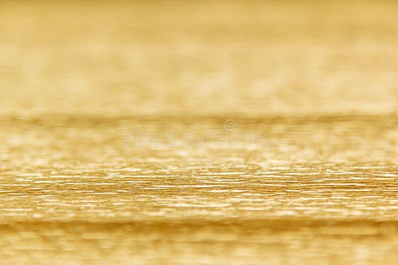 Абстрактная предпосылка золота с нерезкостью стоковые изображения rf