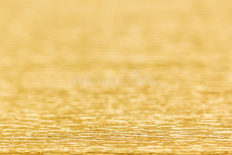 Абстрактная предпосылка золота с нерезкостью стоковая фотография