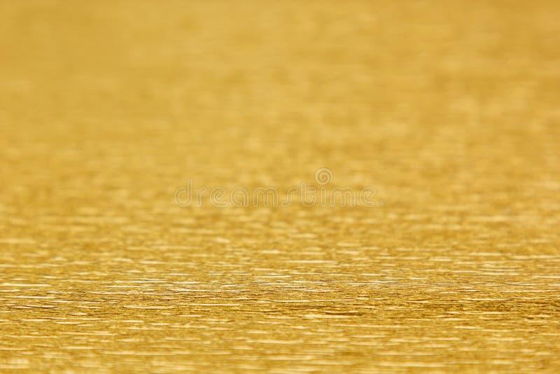 Абстрактная предпосылка золота с нерезкостью стоковое изображение rf