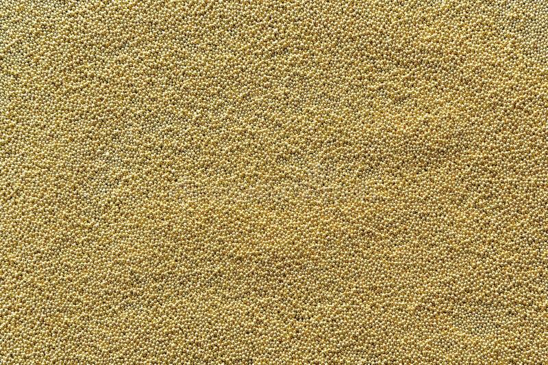 Абстрактная предпосылка золота с частицами металла золота стоковая фотография