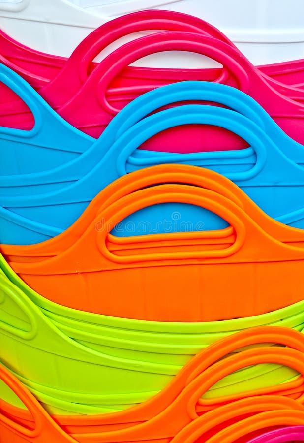 Абстрактная предпосылка красочных пластичных корзин стоковое изображение rf