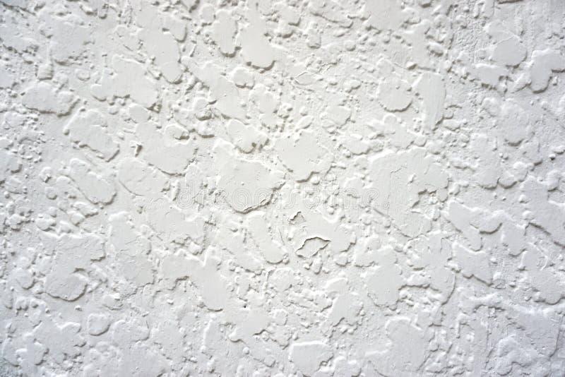 Абстрактная предпосылка grunge - белизна запятнанная стена стоковые фото